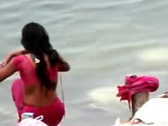 Indian woman bathing in ganges brooklet backless open