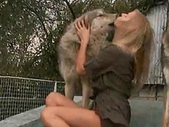 Horny with an increment of horny mistress kisses a dog on the porch of the domicile