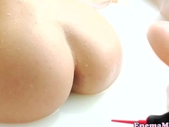 Milkenema lesbian squirting in a difficulty shampooing